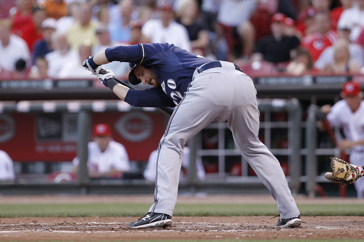 Jonathan Lucroy  tries to avoid being hit by a pitch during last night's game.