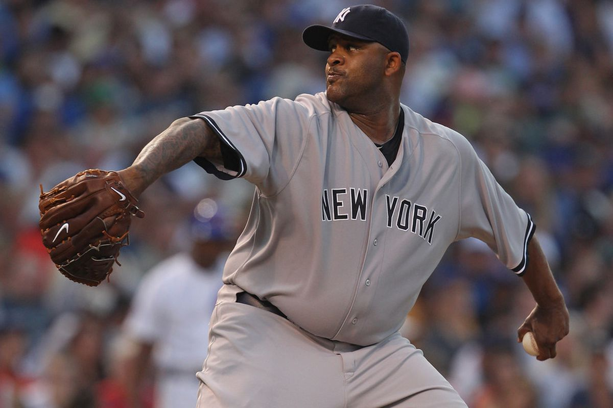CHICAGO, IL - JUNE 19:  Starting pitcher C.C. Sabathia #52 of the New York Yankees delivers the ball against the Chicago Cubs at Wrigley Field on June 19, 2011 in Chicago, Illinois.  (Photo by Jonathan Daniel/Getty Images)