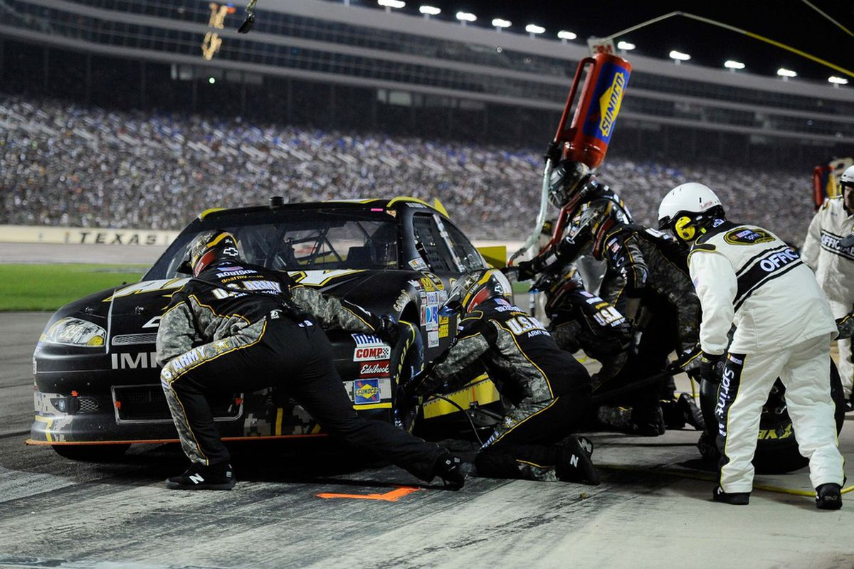 Apr 14, 2012; Fort Worth, TX, USA; Sprint Cup Series driver Ryan Newman (39) makes a pit stop during the Samsung Mobile 500 at Texas Motor Speedway. Mandatory Credit: Jerome Miron-US PRESSWIRE