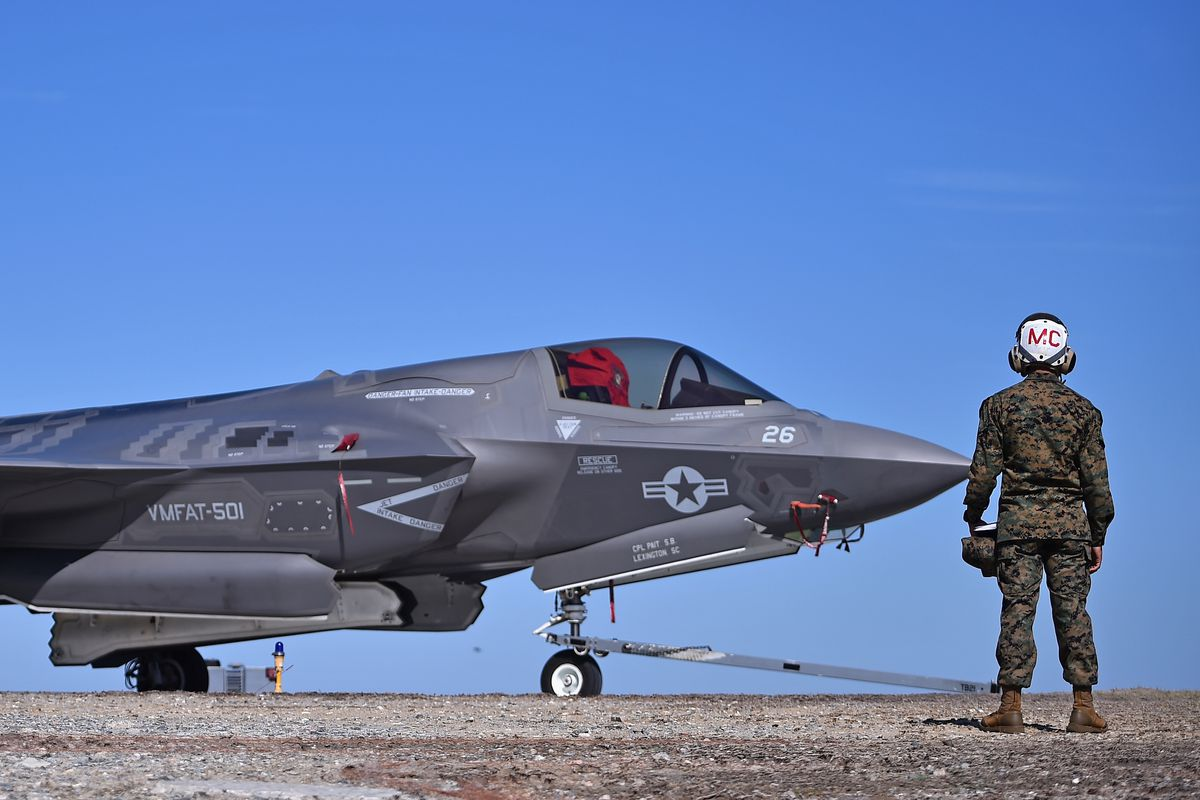 A crew member stands beside a F-35B Lightning II combat aircraft at Marine Corps Air Station Beaufort on March 8, 2016, in Beaufort, South Carolina.