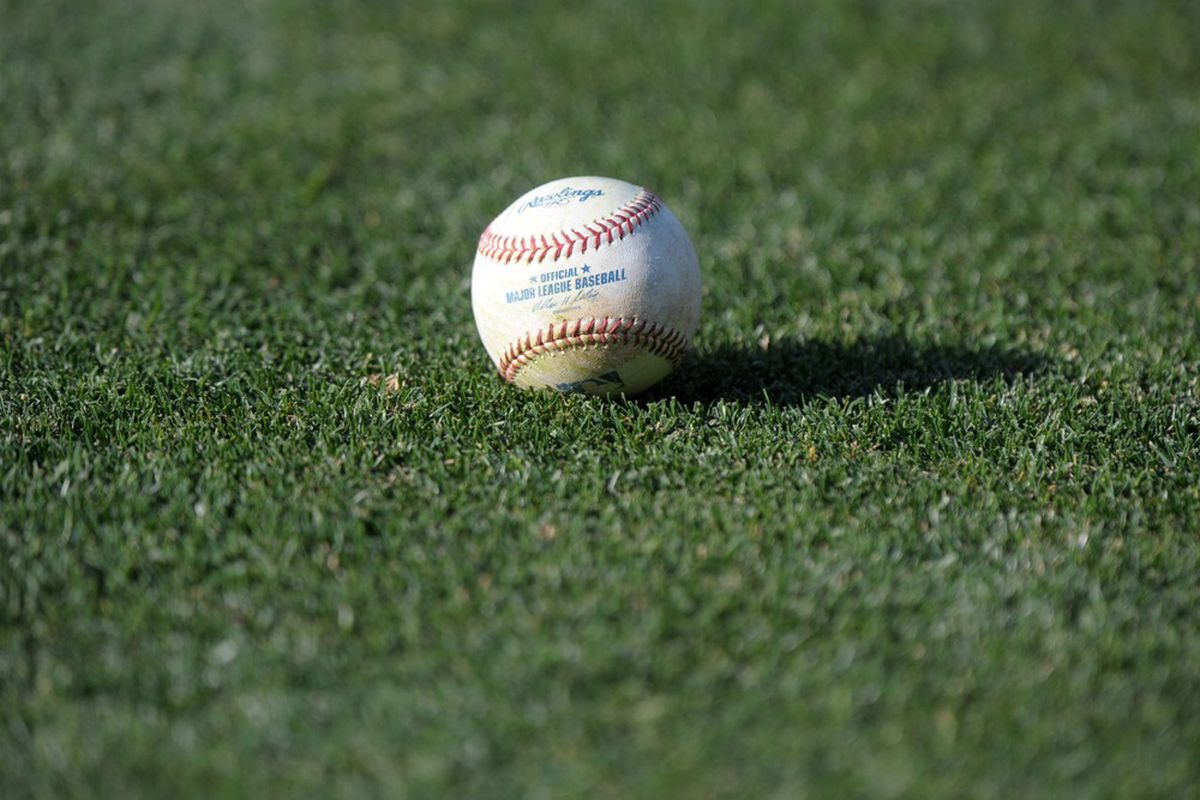 May 30, 2012; Los Angeles, CA, USA; General view of a baseball on the field before the MLB game between the Milwaukee Brewers and the Los Angeles Dodgers at Dodger Stadium. Mandatory Credit: Kirby Lee/Image of Sport-US PRESSWIRE