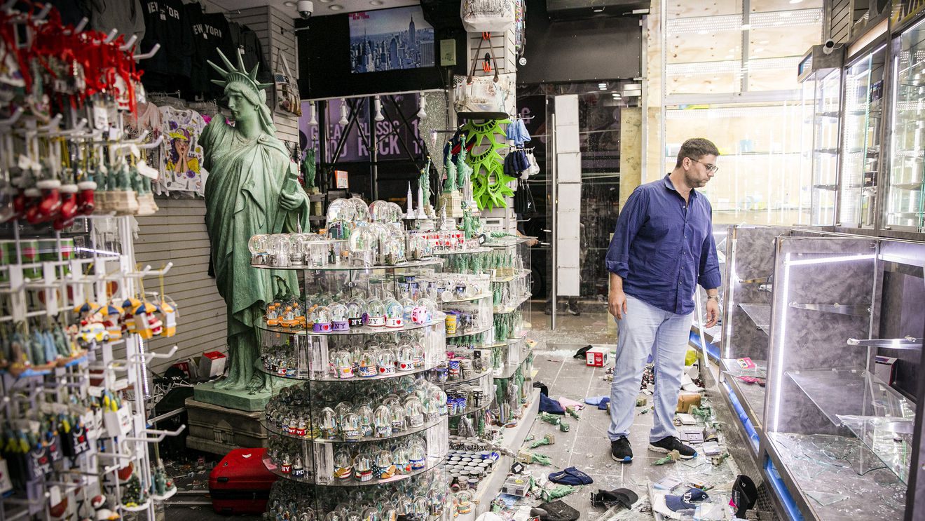 looking at his store's damage
