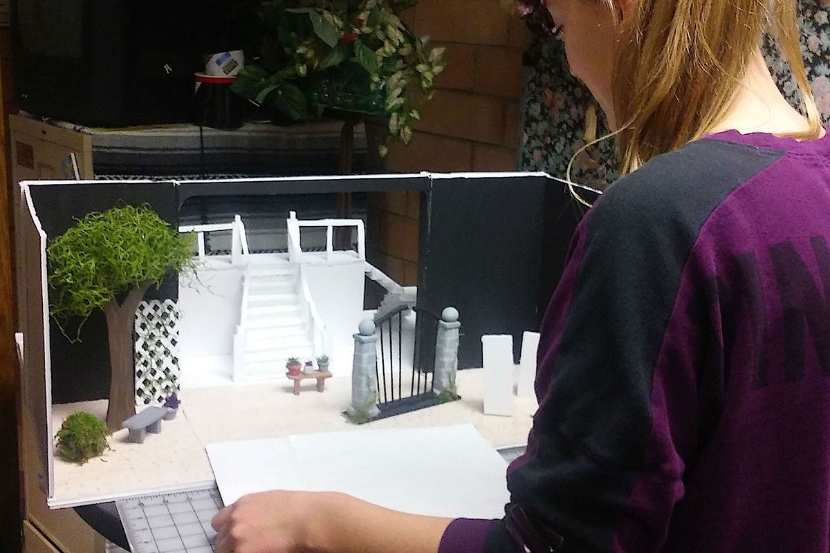 One of Kelly Jo Smith's students with her project on theater design.