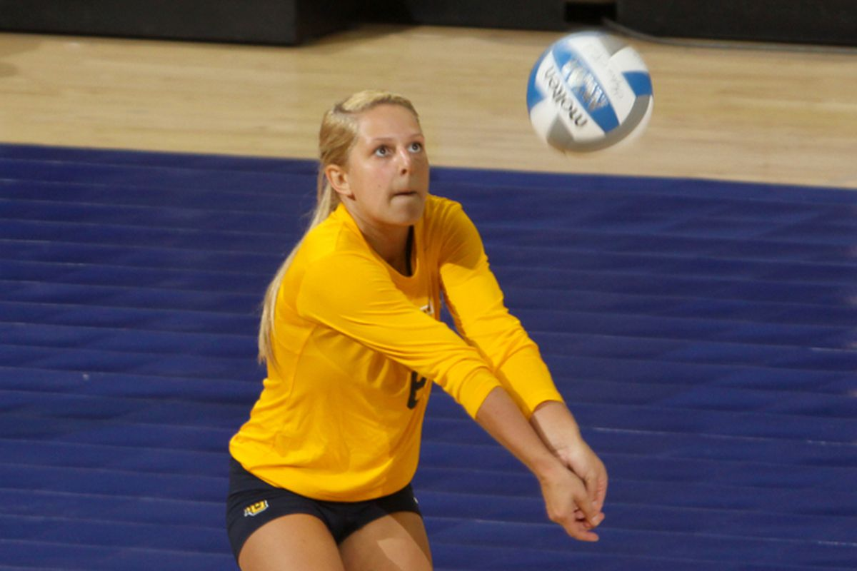 Marquette libero Julie Jeziorowski continues to close in on the all time digs record.