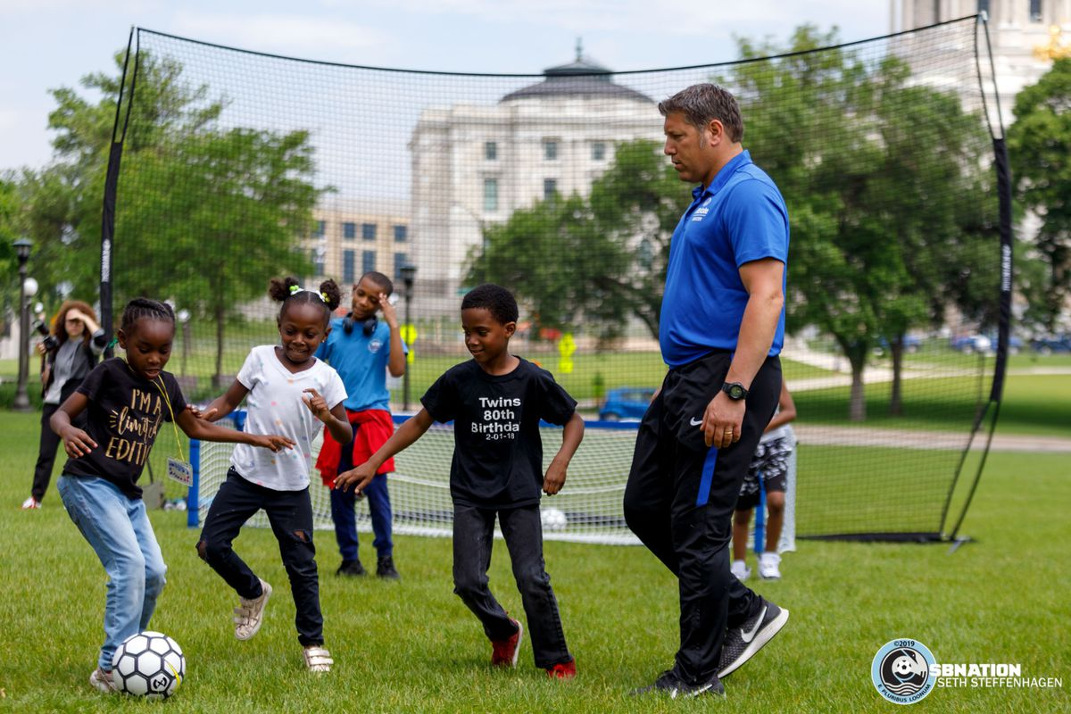June 17, 2019 - Saint Paul, Minnesota, United States - Tony Meola coaches local kids from the Sanneh Foundation as they play soccer at the Allstate Day For Play event on the lawn of the Minnesota State Capitol.