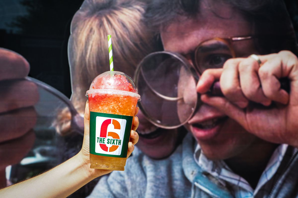 A drink a plastic cup in front of a Honey I Shrunk the Kids poster.