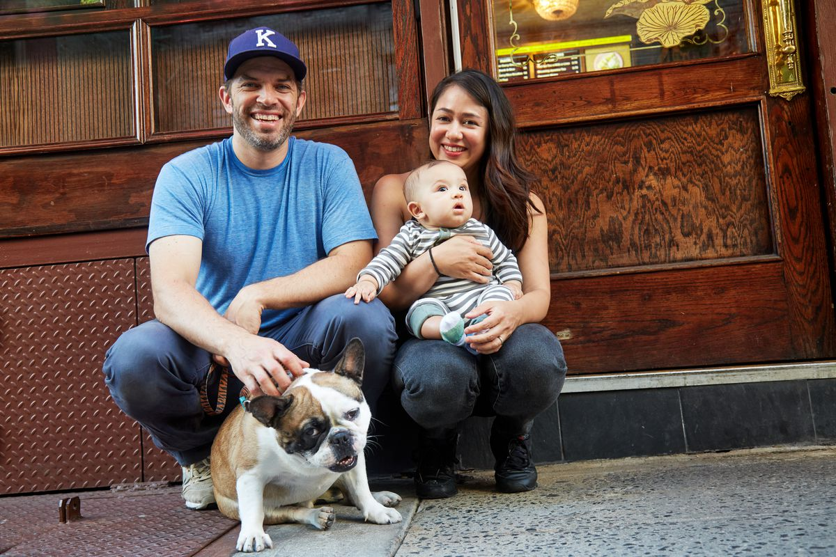 Matt Danzer and Ann Redding, who is holding a baby. A dog is also there.