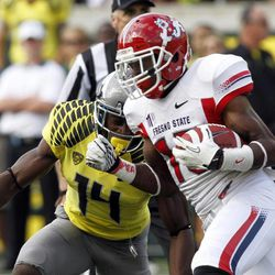 Fresno State wide receiver Davante Adams, right, runs against Oregon defender Ifo Ekpre-Olomu during the first half of an NCAA college football game in Eugene, Ore., Saturday, Sept. 8, 2012.