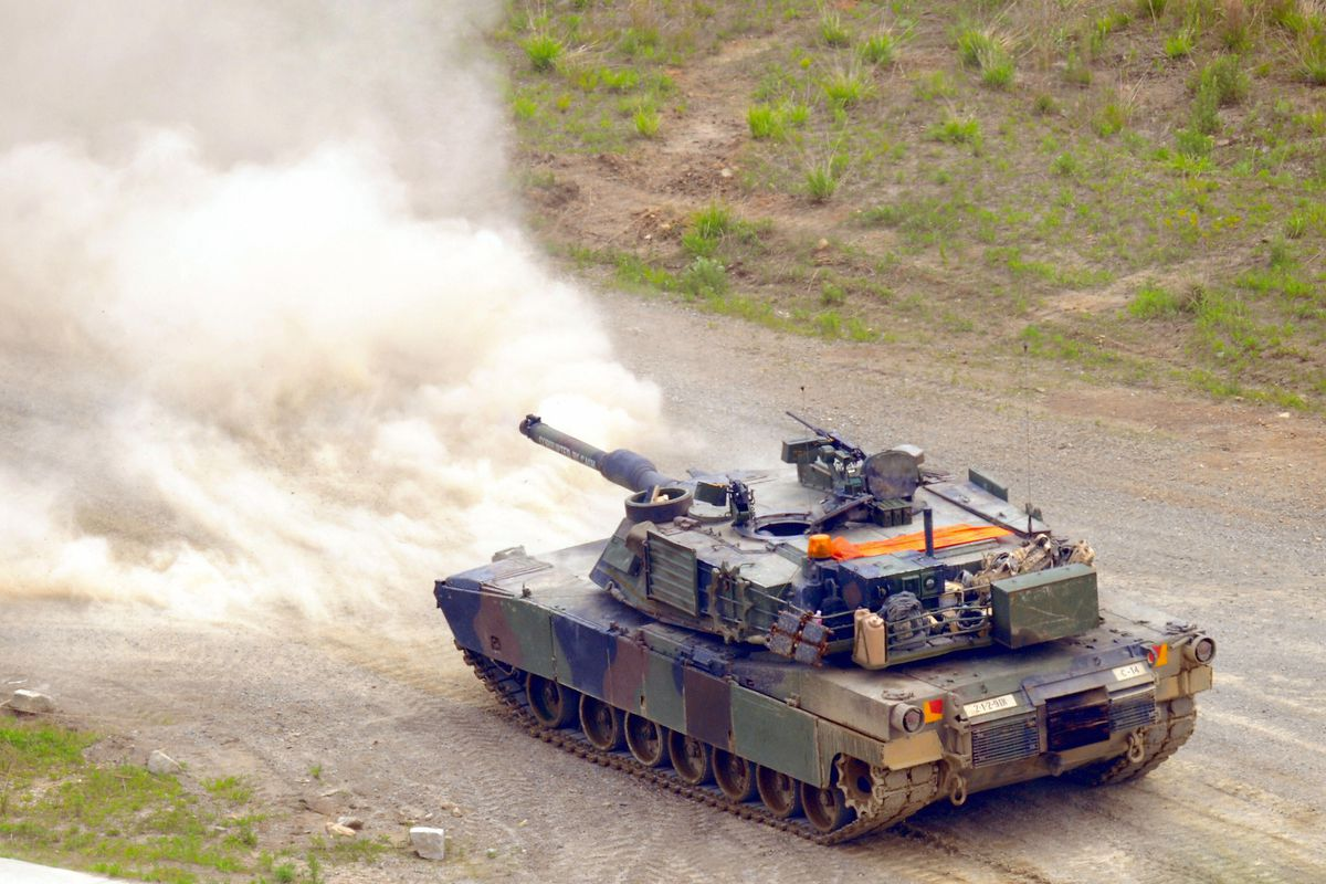A US M1 tank fires during a joint milita
