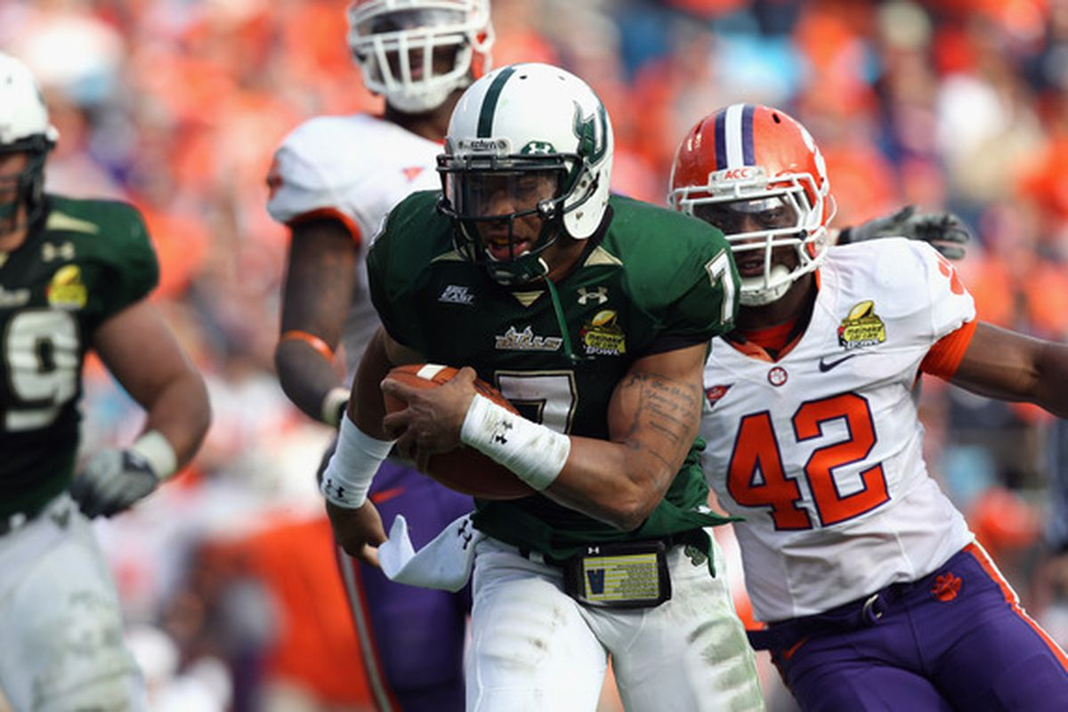 CHARLOTTE NC - DECEMBER 31:  B.J. Daniels #7 of the USF Bulls runs for a touchdown against the Clemson Tigers during their game at Bank of America Stadium on December 31 2010 in Charlotte North Carolina.  (Photo by Streeter Lecka/Getty Images)