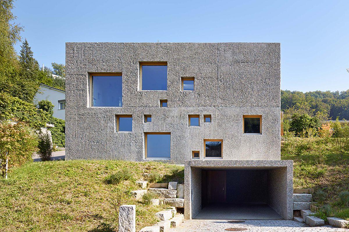 Concrete House In Switzerland Looks Like A Block Of Swiss