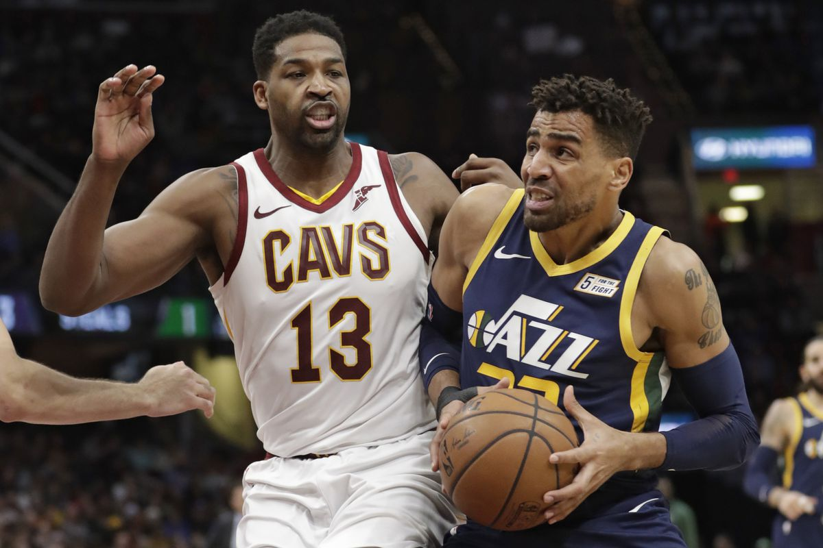 FILE - Utah Jazz's Thabo Sefolosha (22), from Switzerland, drives past Cleveland Cavaliers' Tristan Thompson (13) in the first half of an NBA basketball game, Friday, Jan. 4, 2019, in Cleveland.