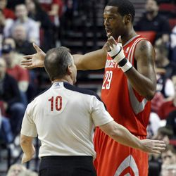 Houston Rockets center Marcus Camby, right, complains to refereeRon Garretson during the first quarter of their NBA basketball game against the Portland Trail Blazers in Portland, Ore., Monday, April 9, 2012.
