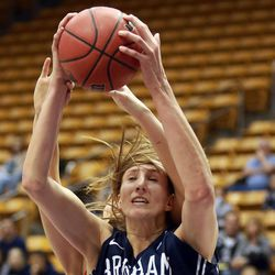 BYU's Jennifer Hamson grabs the rebound during a women's basketball game against the University of Utah at the Marriott Center in Provo on Saturday, Dec. 14, 2013. Utah won in double overtime 82-74.