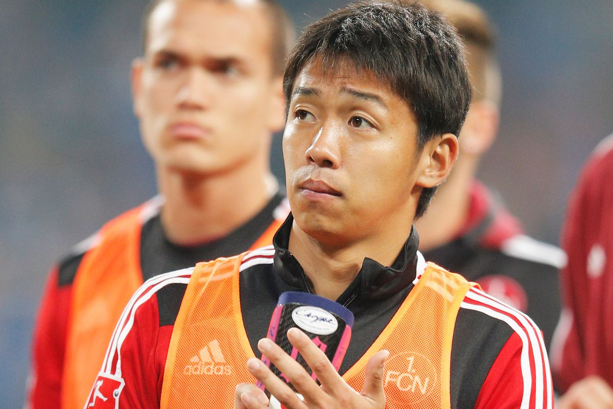Unused substitute Hiroshi Kiyotake looks on as his Nürnberg teammates are unable to save the club from relegation on the final day of the Bundesliga campaign.