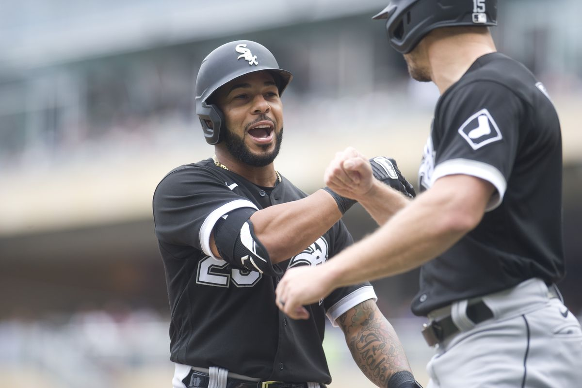 Chicago White Sox second baseman Leury Garcia (28) celebrates his two-run home run with center fielder Adam Engel (right) during the second inning against the Minnesota Twins at Target Field.