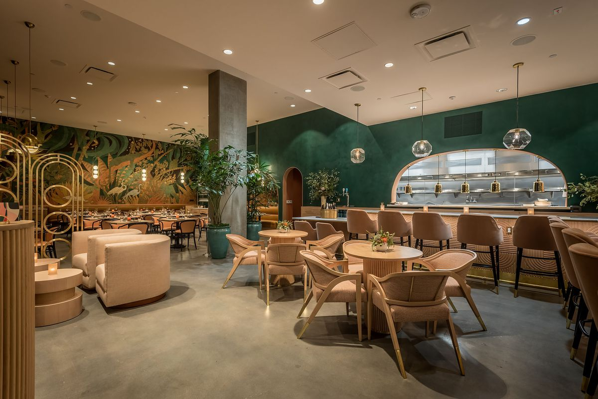 Dark green and peach toned seating inside Red Herring