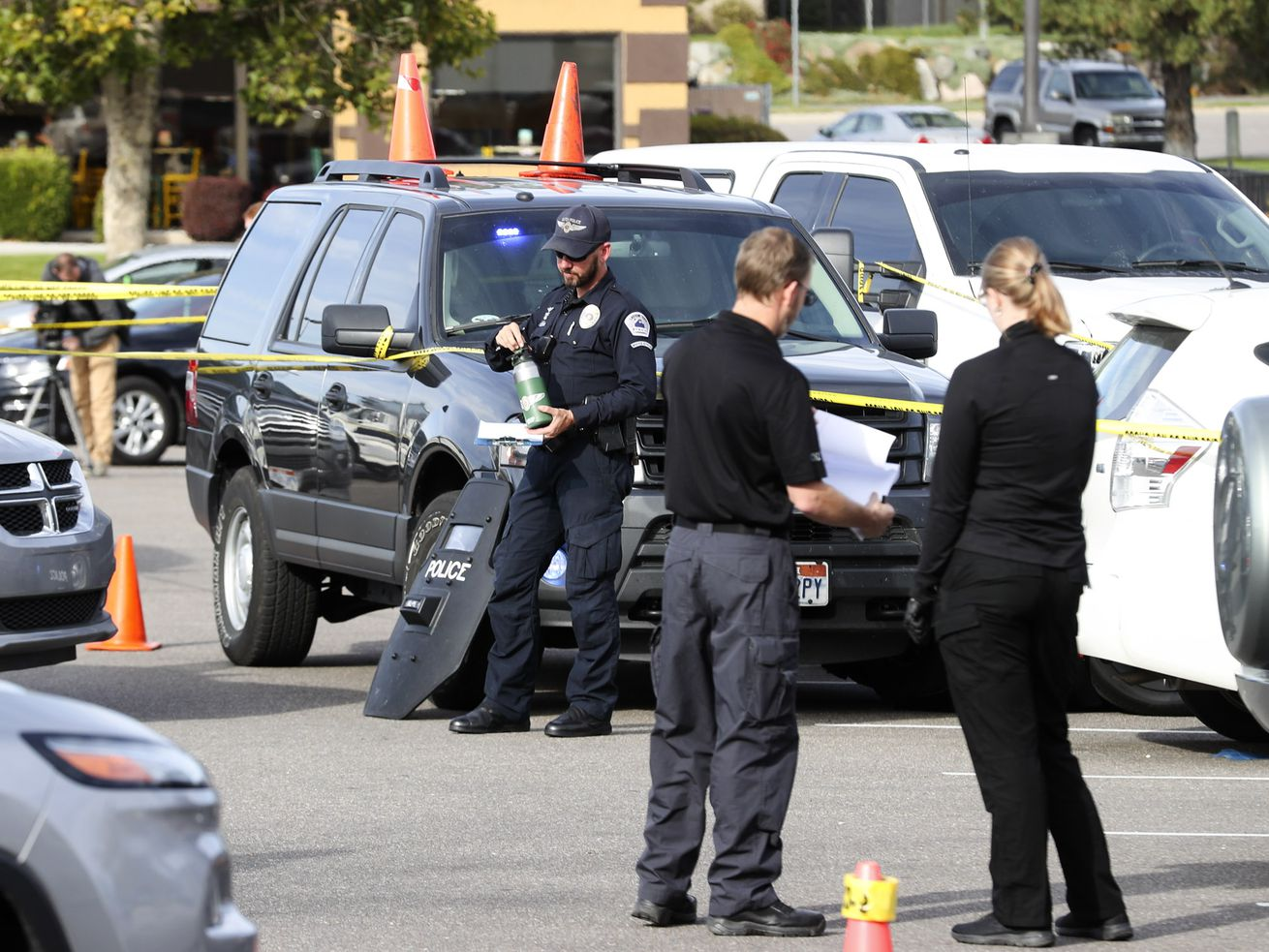 Law enforcement officials gather information at Layton Hills Mall in Layton after one person was shot on Tuesday, Oct. 8, 2019.