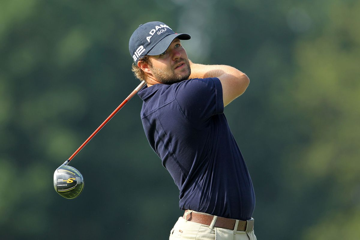 AKRON, OH - Ryan Moore hits his tee shot on the third hole during the third round of the World Golf Championships-Bridgestone Invitational on the South Course at Firestone Country Club in Akron, Ohio.  (Photo by Andy Lyons/Getty Images)