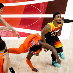 Utah Jazz forward Ersan Ilyasova (7) is charged with an offensive foul as guard Donovan Mitchell (45) drives past Oklahoma City Thunder forward Luguentz Dort (5) during the game at Vivint Smart Home Arena in Salt Lake City on Tuesday, April 13, 2021.
