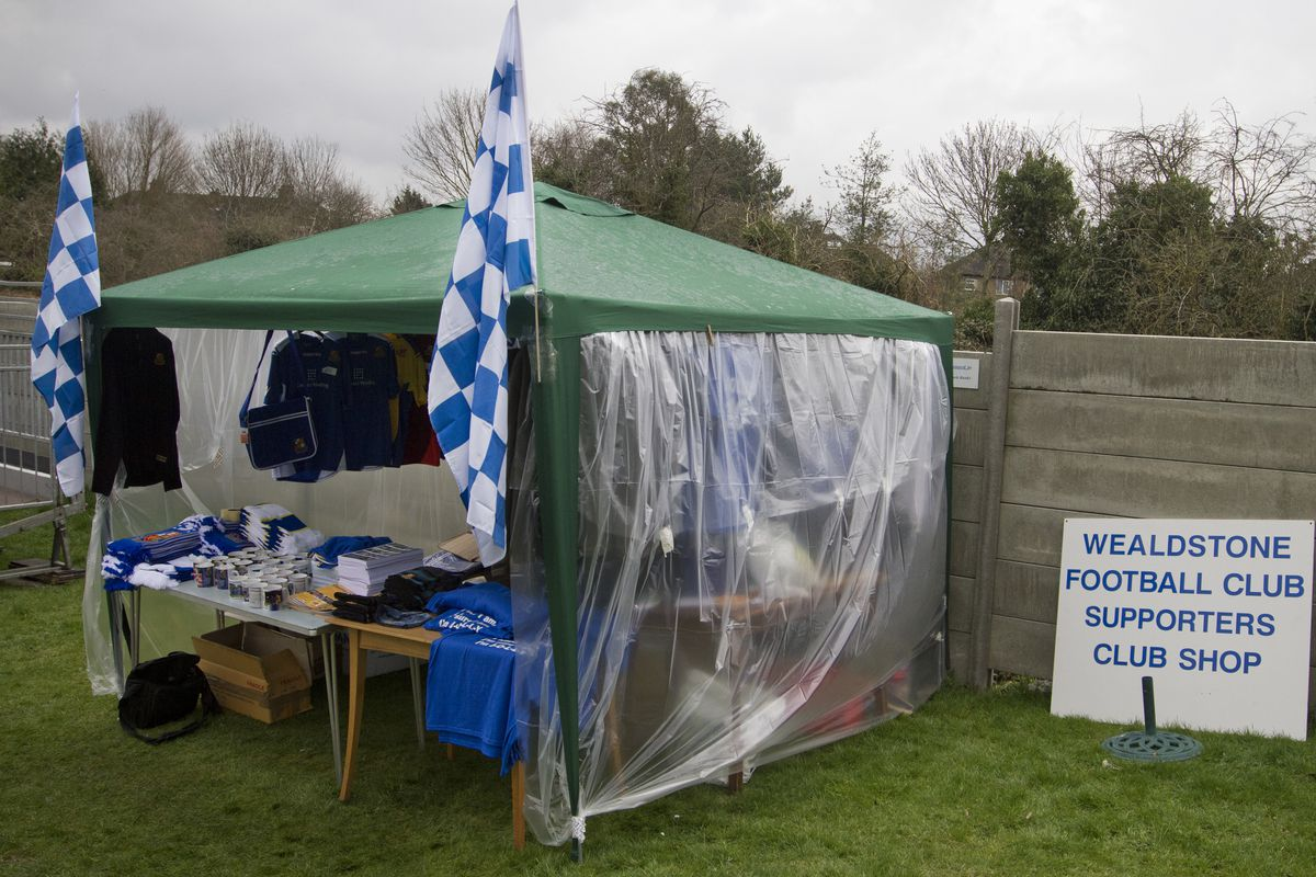 Non league team dreaming of round 3 - A makeshift gazebo selling club souvenirs inside St Georges Stadium, home ground of Wealdstone FC