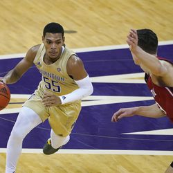 Washington guard Quade Green (55) drives around Utah guard Pelle Larsson, right, during the first half of an NCAA college basketball game, Sunday, Jan. 24, 2021, in Seattle.