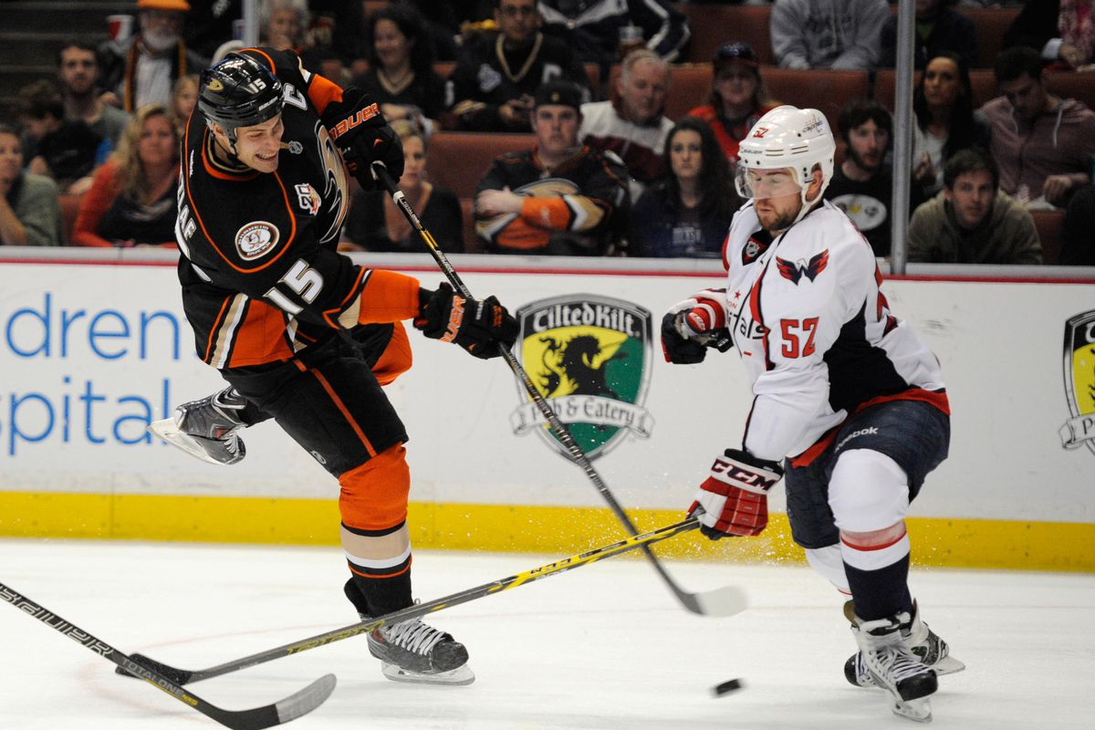 Ryan Getzlaf attempts a shot defended by Mike Green last season at Honda Center.