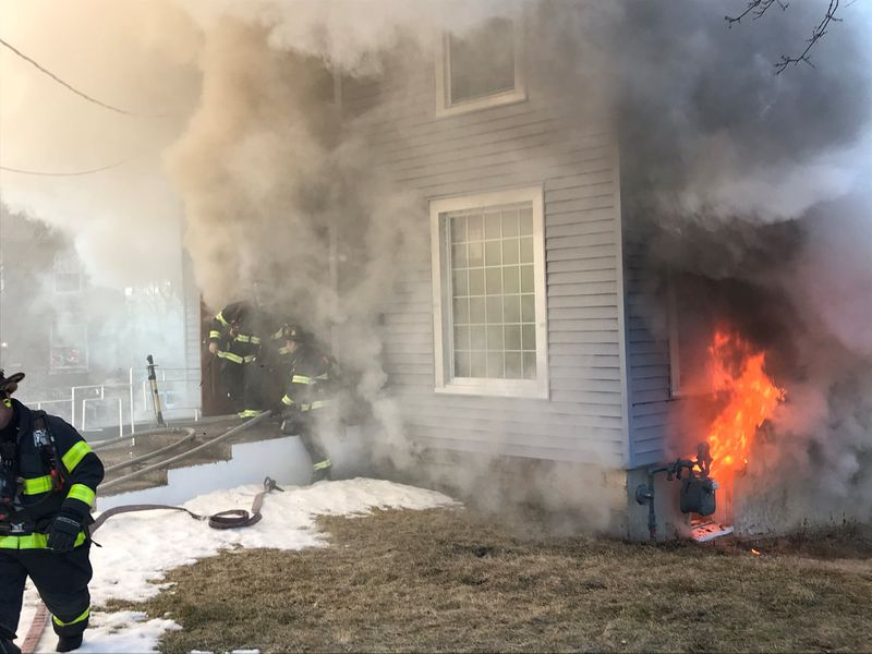 Firefighters battle a blaze in Aurora on March 2 in the 200 block of Downer Place.
