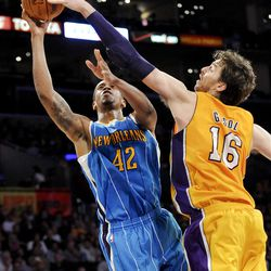 Los Angeles Lakers forward Pau Gasol (16), of Spain, gets a hand on New Orleans Hornets forward Lance Thomas' (42) shot in the first half of an NBA basketball game on Saturday, March 31, 2012, in Los Angeles. (AP Photo/Gus Ruelas)