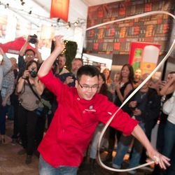 A chef from Martin Yan's forthcoming M.Y. China dances with a noodle