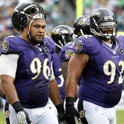 In this Sept. 16, 2012, file photo, Baltimore Ravens nose tackle Maake Kemoeatu (96) walks with defensive end Haloti Ngata (92) and nose tackle Terrence Cody (62) late in the second half of an NFL football game against the Philadelphia Eagles in Philadelphia. For roughly 20 years, Utah has emphasized its ability to recruit polynesian players.