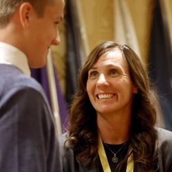 Water polo olympian Courtney Young Johnson talks to her son Maddox Johnson before being honored at the Utah Sports Hall of Fame banquet at the Little America Hotel in Salt Lake City on Monday, Sept. 20, 2021.