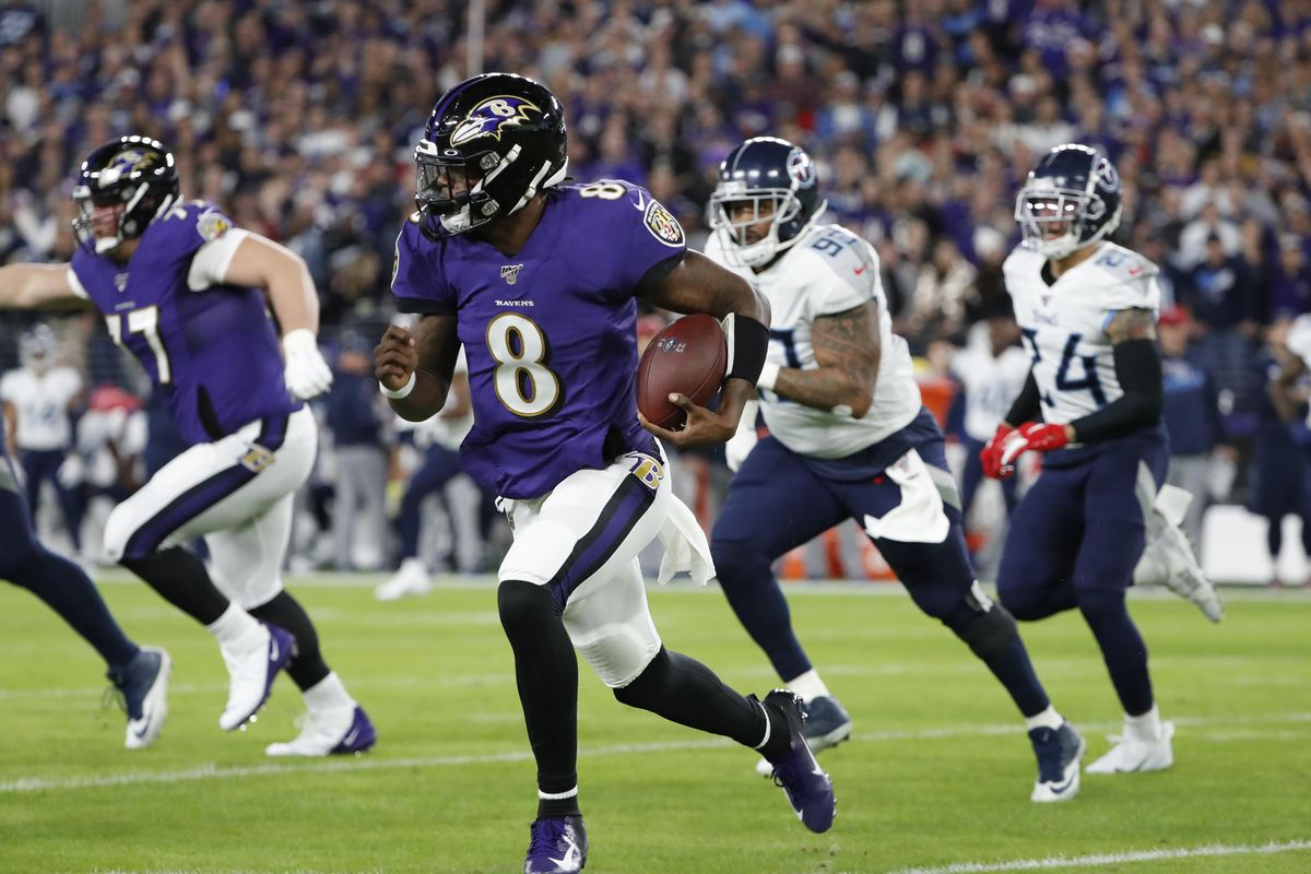 Baltimore Ravens quarterback Lamar Jackson runs the ball against the Tennessee Titans in the first quarter in a AFC Divisional Round playoff football game at M&T Bank Stadium.