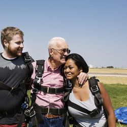 Grandson Jason Ashcroft, left, Wendell Ashcroft, and granddaughter Danielle Garrick share a family hug after landing safely from their first skydiving experience at Skydive Ogden in Ogden on Saturday, Aug. 5, 2017.