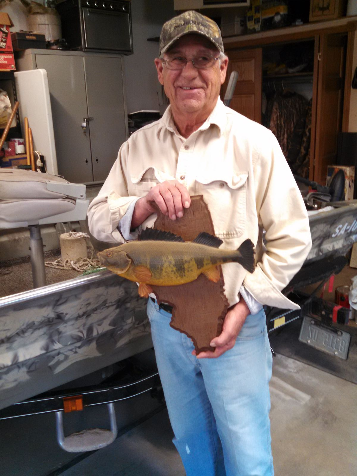 Joe Grega with the mount of his Illinois-record yellow perch, still the record after more than 40 years.<br>Credit: Dale Bowman