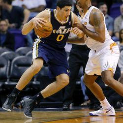 Utah Jazz center Enes Kanter, of Turkey, backs down Phoenix Suns' Channing Frye during the second half of an NBA basketball game on Friday, Nov. 1, 2013, in Phoenix. The Suns won 87-84.