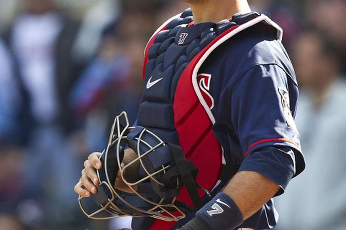 Apr 12, 2012; Minneapolis, MN, USA: Minnesota Twins catcher Joe Mauer (7) looks on during the eighth inning against the Los Angeles Angels at Target Field. The Twins won 10-9. Mandatory Credit: Jesse Johnson-US PRESSWIRE