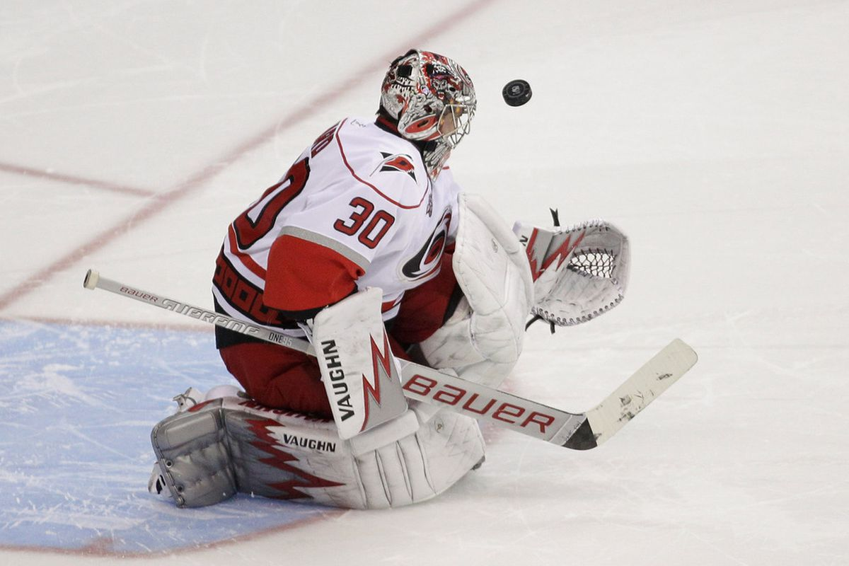 WASHINGTON, DC - MARCH 29:  Goalie Cam Ward #30 of the Carolina Hurricanes blocks a shot on goal during a shootout 3-2 win against the Washington Capitals at the Verizon Center on March 29, 2011 in Washington, DC. (Photo by Rob Carr/Getty Images)