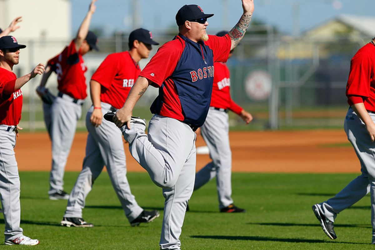 FORT MYERS FL - FEBRUARY 19:  Pitcher Bobby Jenks #52 of the Boston Red Sox stretches during a Spring Training Workout Session at the Red Sox Player Development Complex on February 19 2011 in Fort Myers Florida.  (Photo by J. Meric/Getty Images)