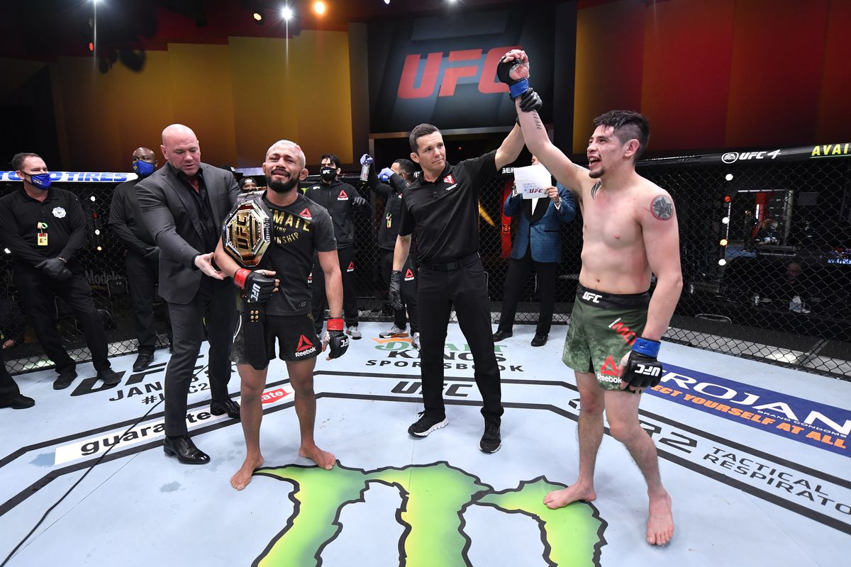 (L-R) Deiveson Figueiredo of Brazil and Brandon Moreno of Mexico react after their flyweight championship bout was declared a majority draw during the UFC 256 event at UFC APEX on December 12, 2020 in Las Vegas, Nevada.