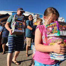 Libby Theurer helps her dad, Jared Theurer carry their fireworks to the car in Bountiful on Thursday, June 29, 2017. In Utah, fireworks can be enjoyed during the three days before, during, and three days after the holiday. People may light fireworks between 11 a.m. and 11 p.m. and as late as midnight on July 4.