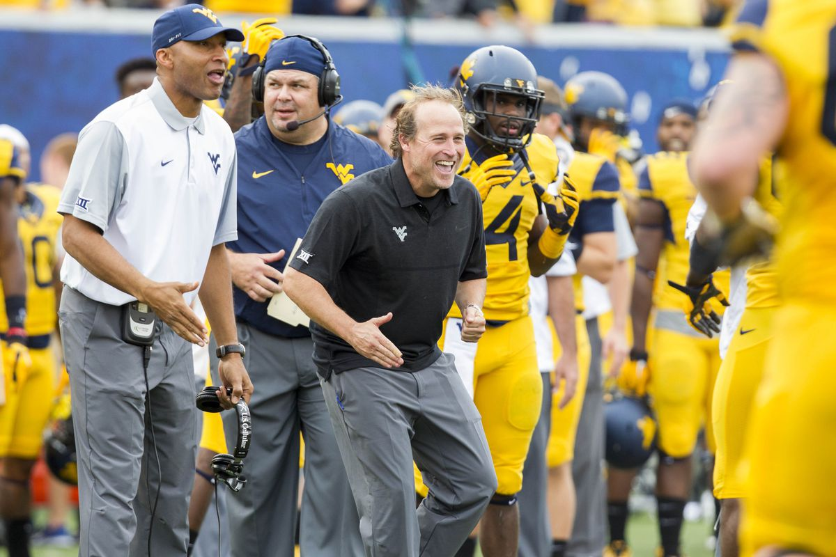 Coach Dana Holgorsen Celebrates a first half for the ages, as WVU dominated Maryland 45-6.
