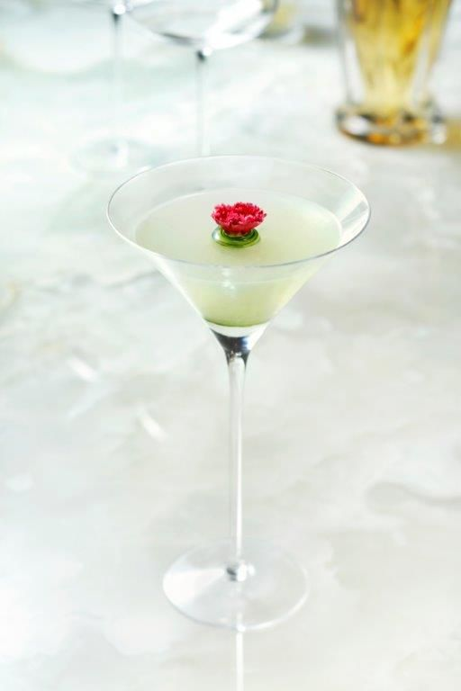 A white cocktail in a martini glass