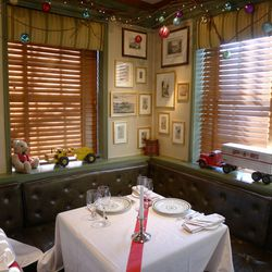 Watts brought in antique toys to decorate the dining room this year. Another festive touch: a choir of Christmas carolers sings at the restaurant every evening the restaurant is open in December. As you'd expect, Christmas Eve is one of the toughest day o