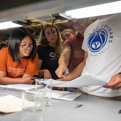 Student researchers gather to look at notes in a lab on the BYU campus in Provo on June 25, 2021. Rio Tinto Kennecott and Brigham Young University researchers are joining forces to develop innovative and sustainable solutions to improve reclamation at the Bingham Canyon Mine. In June 2020, a group of students and professors from the BYU Department of Plant and Wildlife Sciences broke ground on four research projects on land areas surrounding the mine with the goal to increase plant diversity, stability and enhance the aesthetics of areas visible from the Salt Lake Valley.