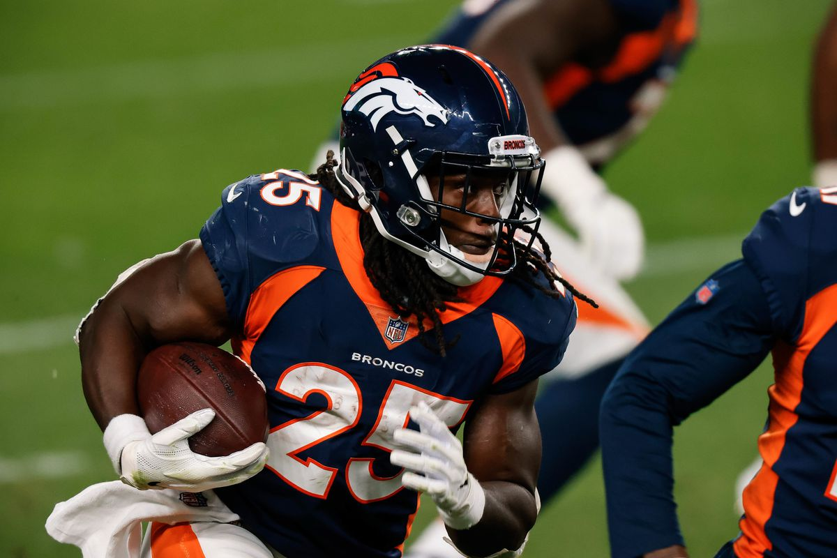 Denver Broncos running back Melvin Gordon III runs the ball on a catch in the fourth quarter against the Tennessee Titans at Empower Field at Mile High.
