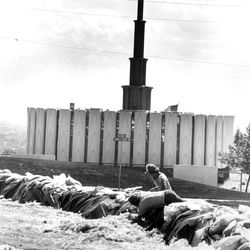 """A sandbag """"river"""" routes water from nearby Rock Canyon around the Provo Temple during massive flooding in the area. June 26, 1983."""