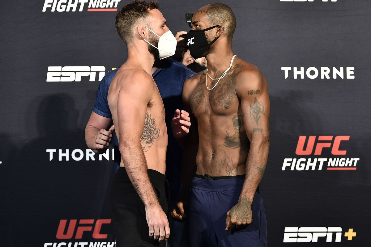 Opponents Lando Vannata and Bobby Green face off during the UFC Fight Night weigh-in at UFC APEX on July 31, 2020 in Las Vegas, Nevada