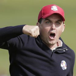 USA's Keegan Bradley celebrates after winning their foursomes match on the 15th hole at the Ryder Cup PGA golf tournament Friday, Sept. 28, 2012, at the Medinah Country Club in Medinah, Ill. (AP Photo/Charlie Riedel)