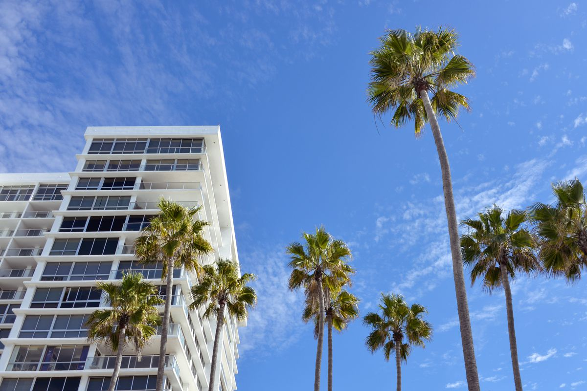 Apartment building and palm trees